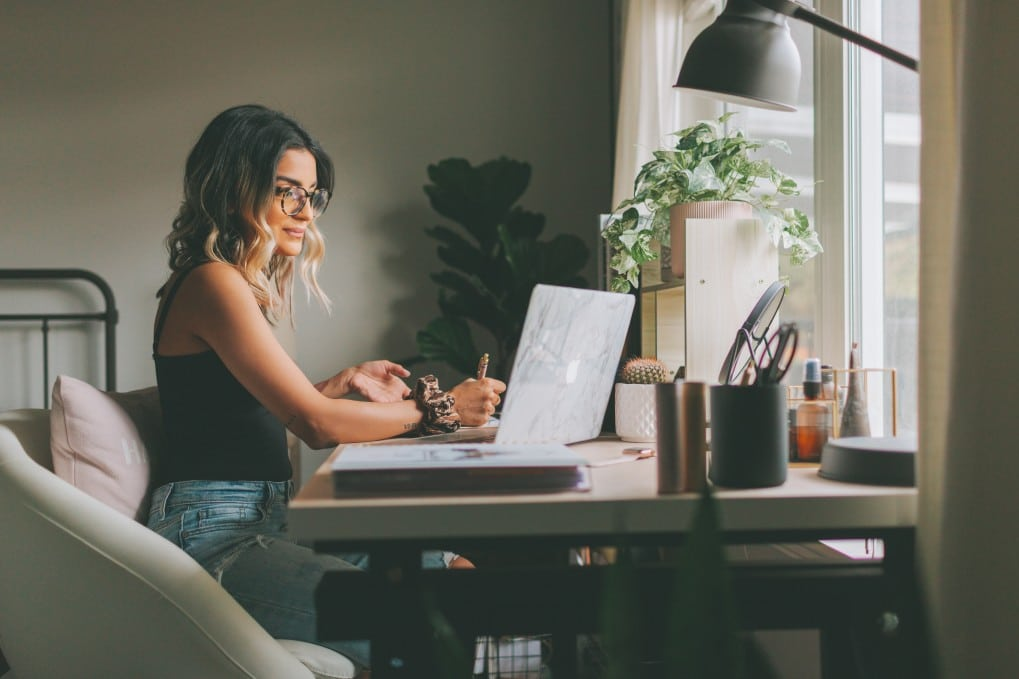 young woman working at her laptop